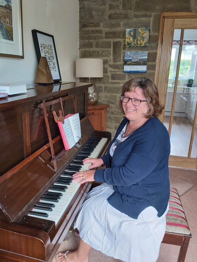 Kathy playing the piano