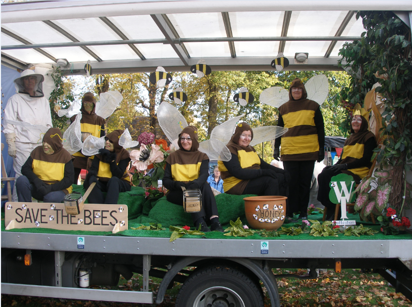A group of women dressed in bee costumes