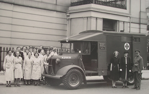 WI ambulance being handed over by Lady Denman outside the London HQ of NFWI