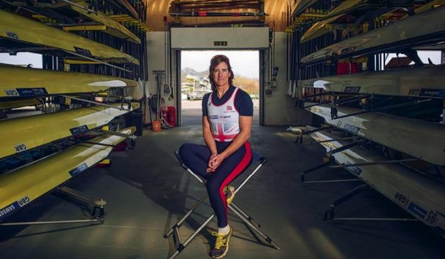 Katerine Grainger sat on a stall in her GB kit surounded by rowing boats