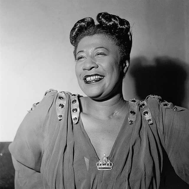 Black and white image of smiling Ella Fitzgerald