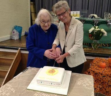 Phyllis & Diane cutting cake