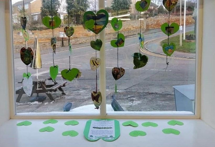 Shop window with green hearts display