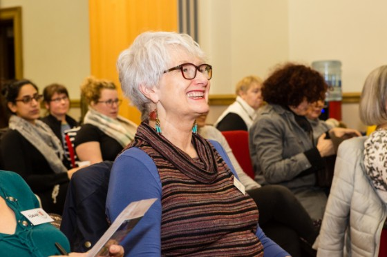 A smiling women at a WI Meeting