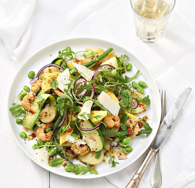Potato, Courgette and Prawn Salad in a white bowl