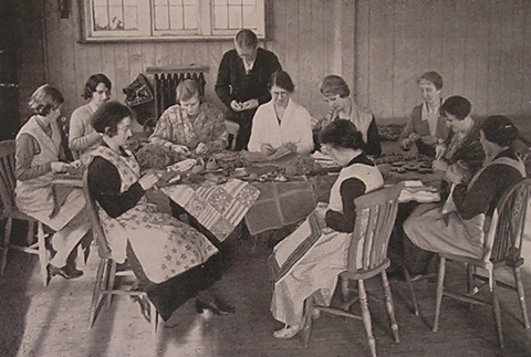 WI members teaching rug making to the unemployed