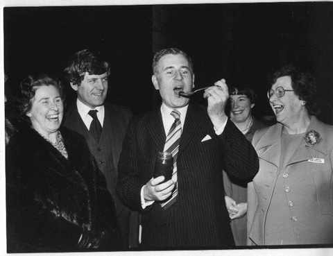 Patricia Batty Shaw giving an MP a taste of WI jam
