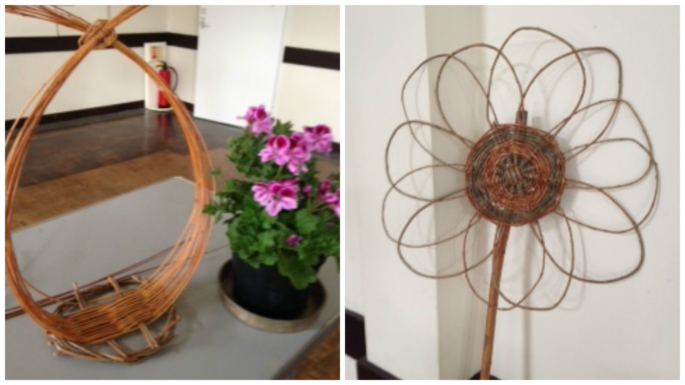 A picture showing a hand made willow basket and willow sun flower
