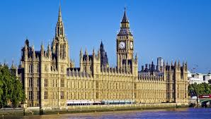 the picture shows the front of the Houses of Parliament, London, UK. Sunny picture with a bright blue sky.