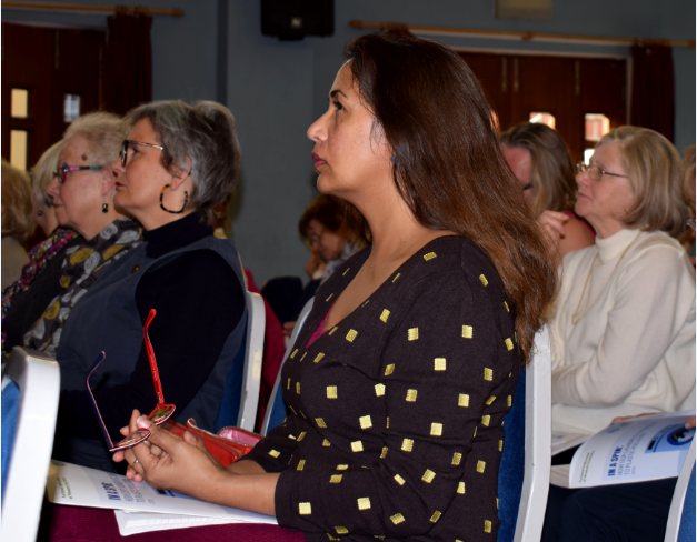 Women sitting in the audience at a conference