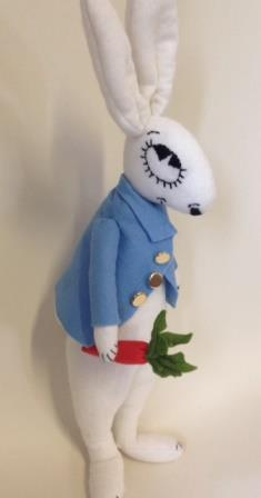 White felt rabbit dressed up as peter rabbit