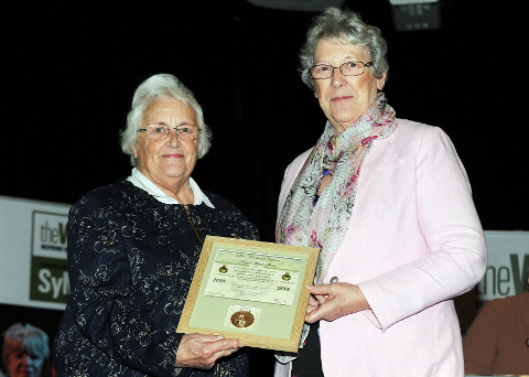 Myra Thomas accepting the Rose Bowl award on behalf of Glamorgan Federation