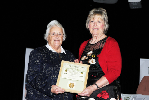 Margaret Maguire accepting the Brecon Cup award on behalf of Glamorgan Federation