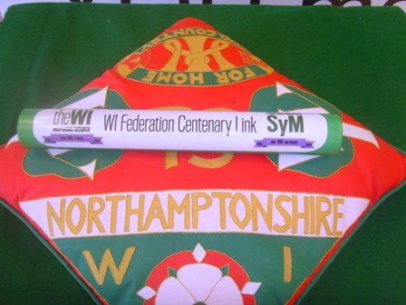 Centenary Baton on Northamptonshire Federation's cushion