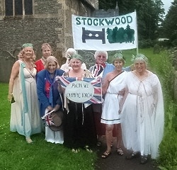 dressed in costume as greeks at handover of wi olympic torch